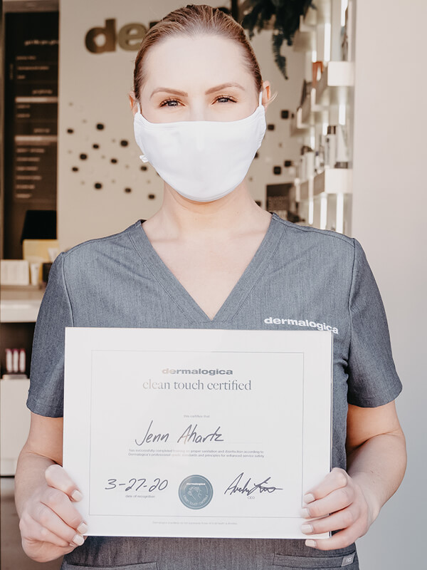 women holding a certificate