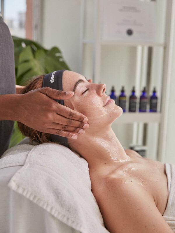 A woman receiving a dermalogica treatment